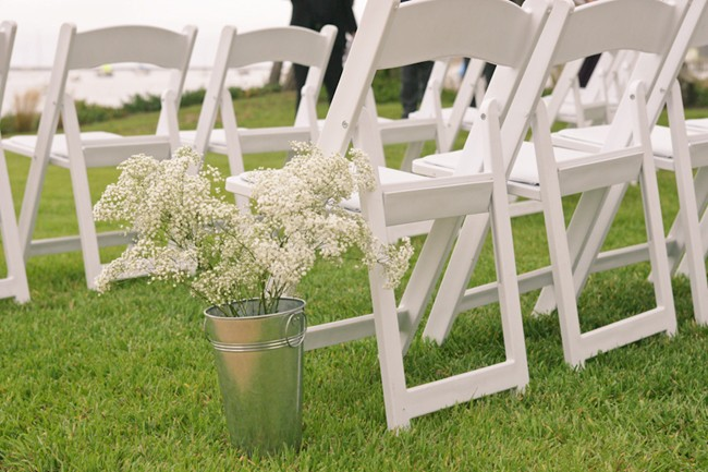 Ceremony seating, white chairs and babys breath