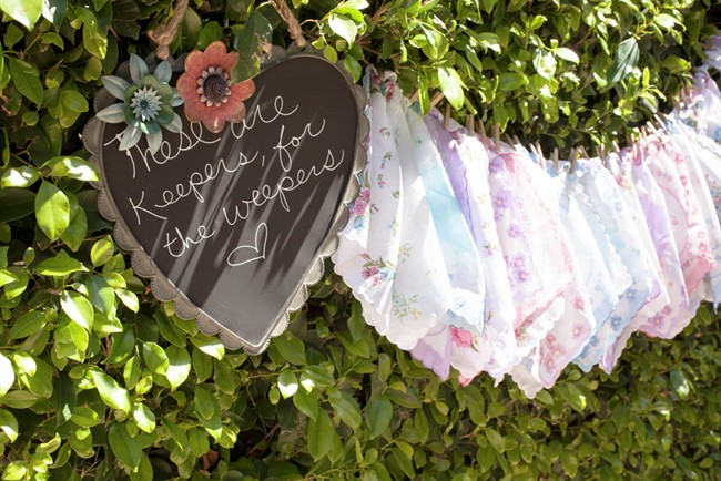 Wedding handkerchiefs hanging from tree at ceremony