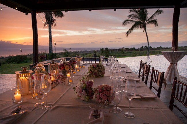 head table with view of sunset and palm tress at Hale Ko'olani