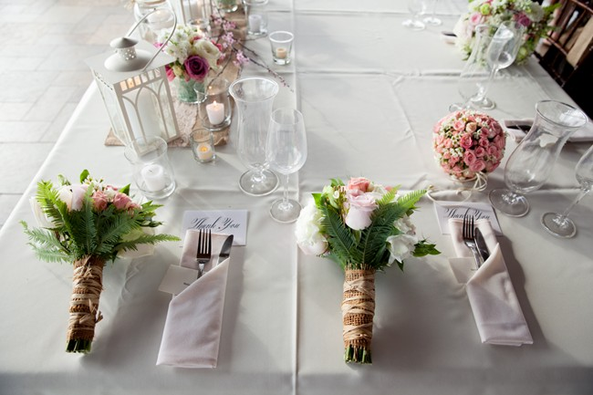 head table with flower bouquet on table