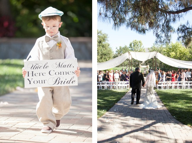 here come the bride sign carried by boy