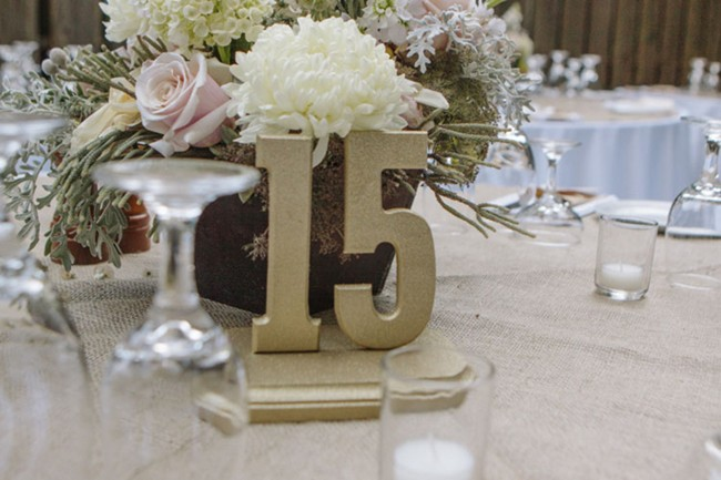 table number fifteen with flower bouquet centerpiece