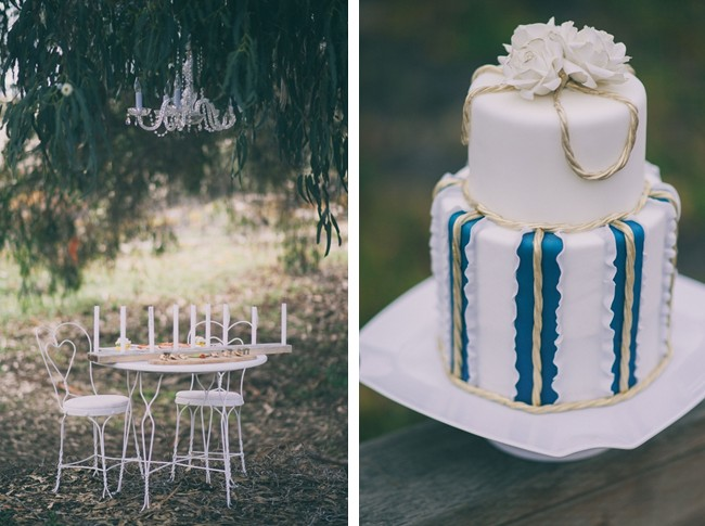 Outdoor wedding reception table with chandelier and nautical themed wedding cake