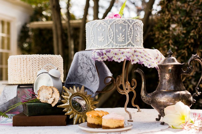 cakes sit on vintage platter with Alice in Wonderland styled shoot decor