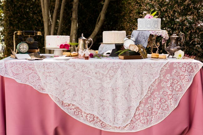 Alice in Wonderland styled shoot at Arlington Hall at Lee park dessert table with pink tablecloth and doily