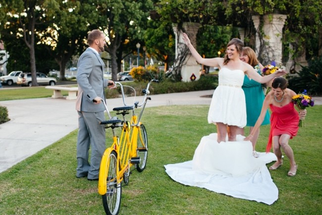 Bride and groom with bicycle made for two and bride wearing a convertible dress