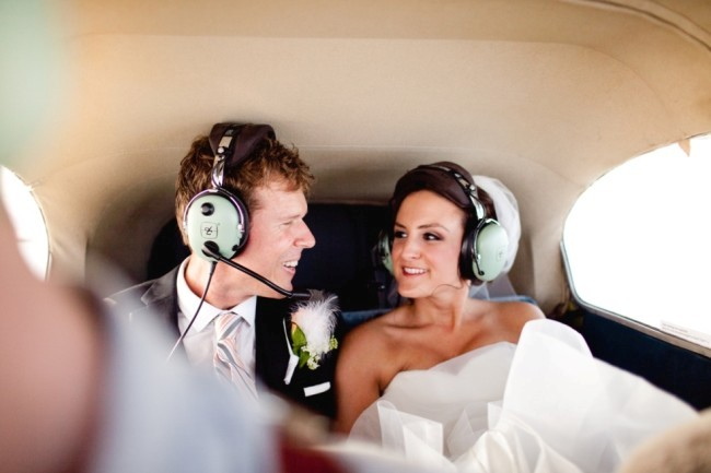 Bride and groom in back of an air plane