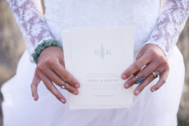 Bride holding up a white invitation
