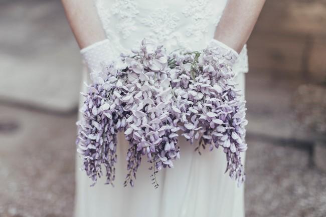 Bride Holding wisteria