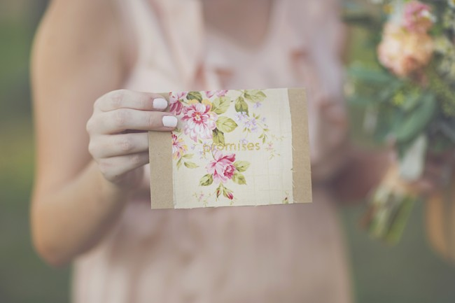 Bridesmaids holding a promise card