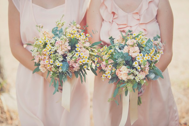 Bridesmaids with flower bouquets