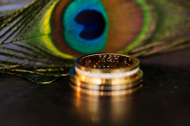 Wedding bands with peacock feather