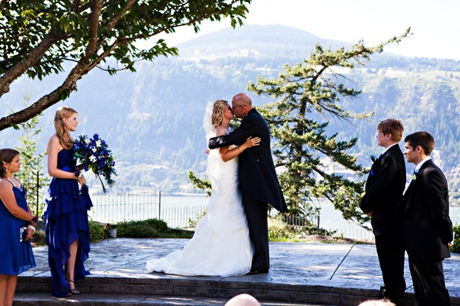 Bride and Groom kissing with view in the back ground at Columbia gorge hotel