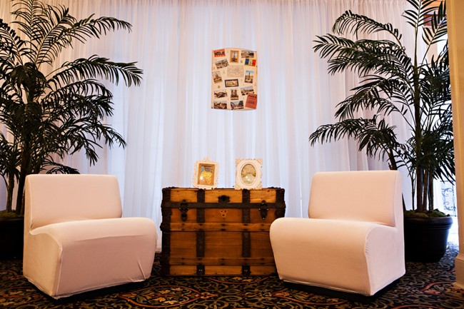 seating with vintage trunk and palm trees