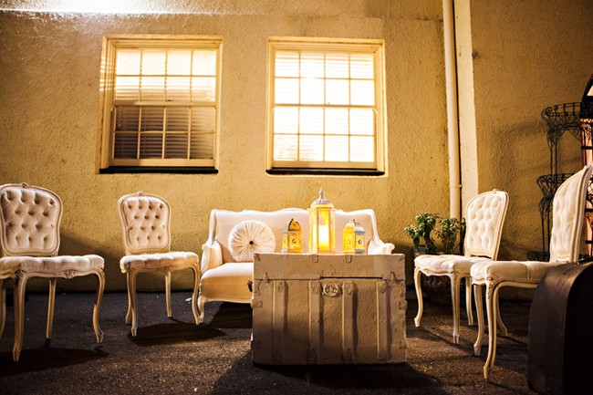 vintage seating with lanterns on vintage white trunk