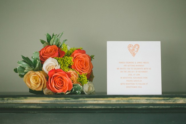 Orange white and yellow bridal bouquet with invitation