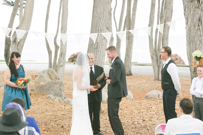 Bride and groom at the altar under white bunting