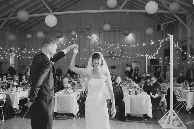 bride and groom dancing with lanterns and lights
