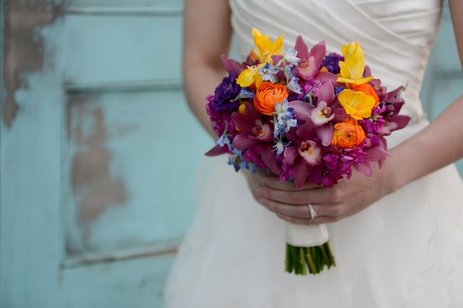 wedding bouquet with purple, yellow, orange and blue flowers
