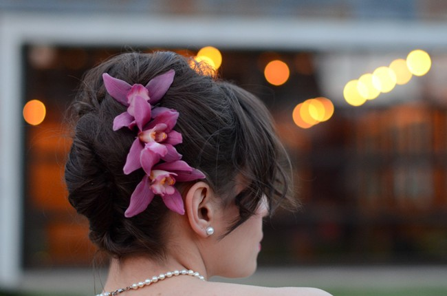 bride with purple orchids in her hair
