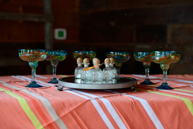 margarita glasses with small patron bottles