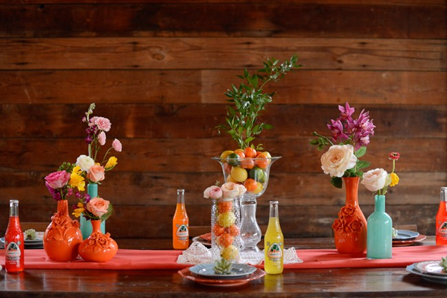 colorful reception table with Mexican Soda and friut