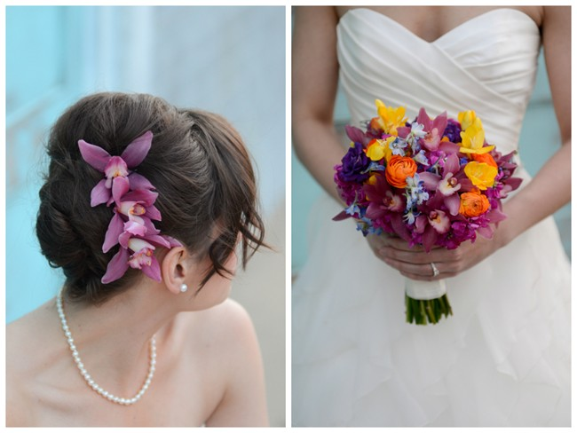 Purple orchids in brides hair with orange, blue, purple and yellow bridal bouquet