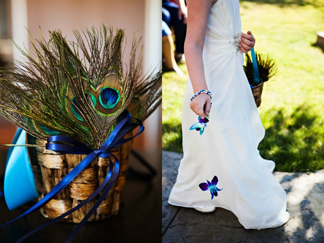 Flower girl holding a basket with peacock feathers