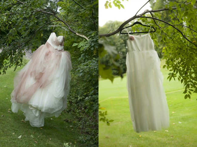 Pink wedding dress and flower girl dress  hanging from a tree