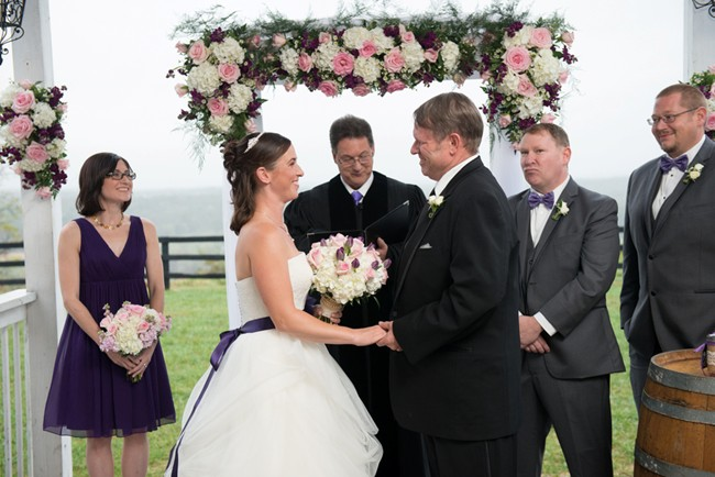 Bluemont Vineyard Wedding Ceremony- Bride and groom standing at altar with pink and white flowers