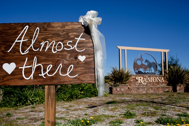 """Almost there"" sign for wedding ceremony"