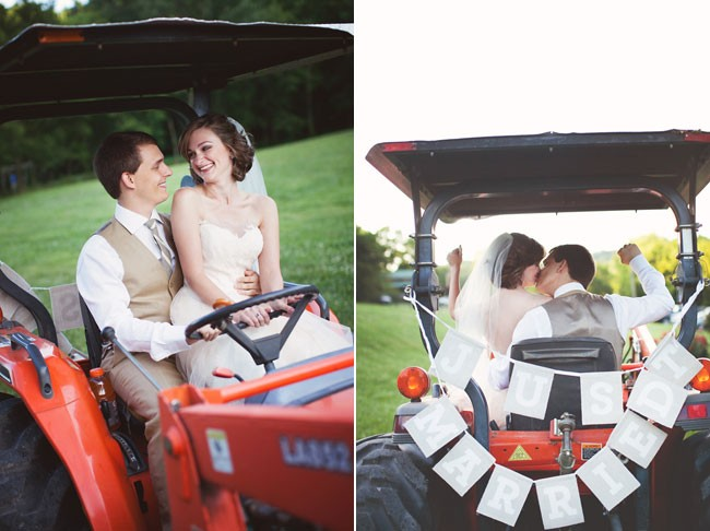 Bride and groom riding a tractor with a just married sign