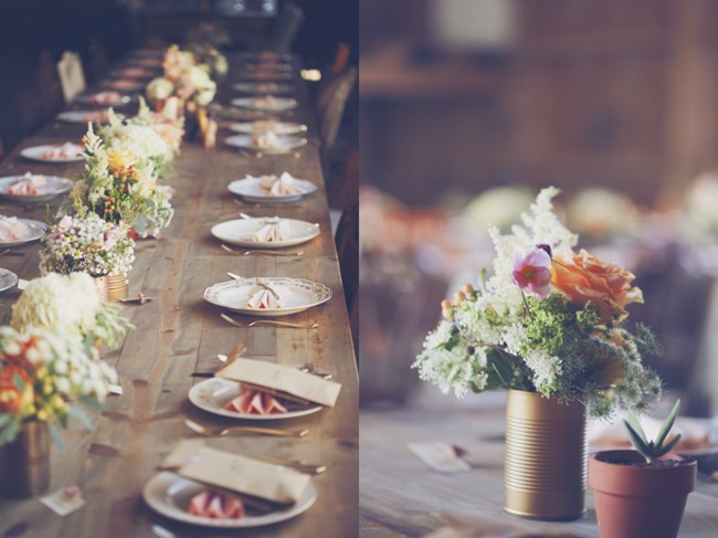 long wood board wedding reception table with flowers