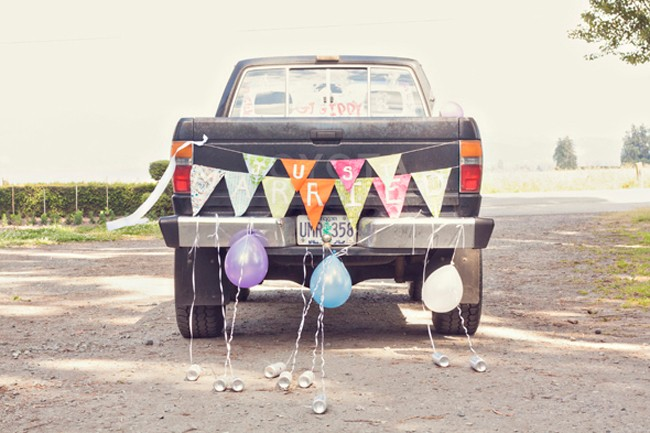 "Truck decorated with ""just married"" decor"
