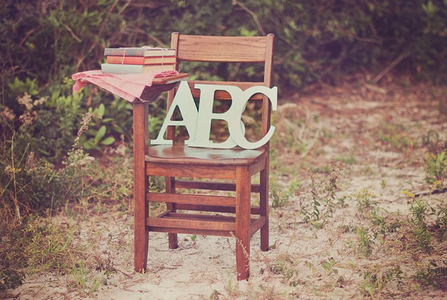 """A vintage desk with the letter """"ABC"""" on the seat and vintage books"""
