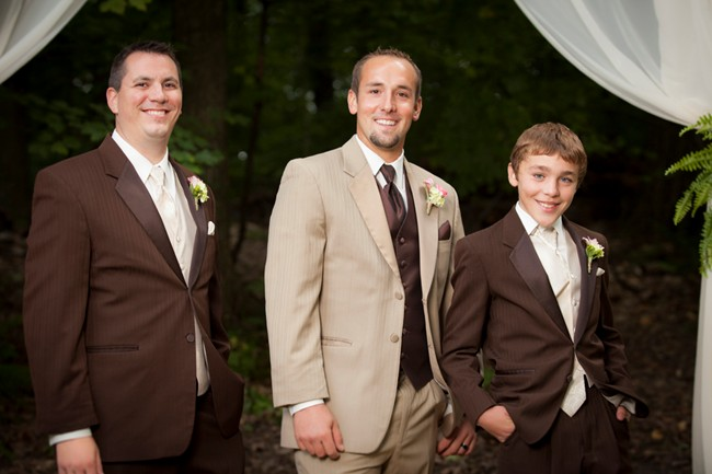 Groom in sandy color suit with grooms men