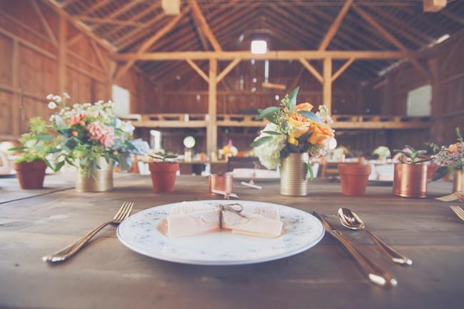 table setting and decor at barn wedding reception