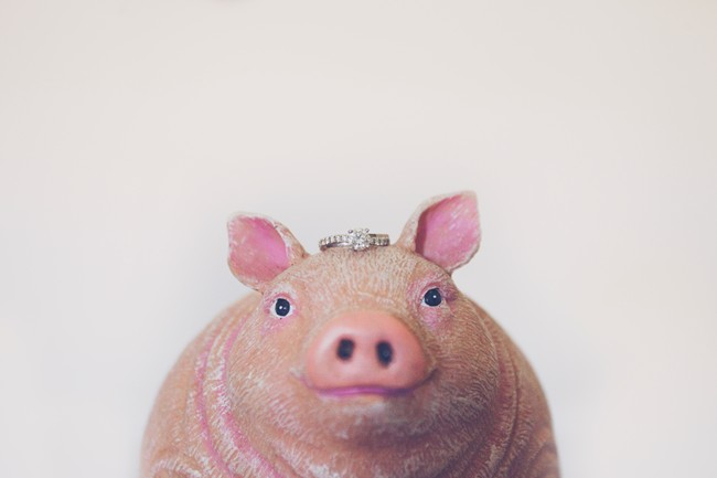 pig statute with wedding ring on its head