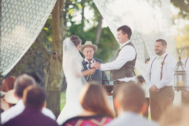 bride and groom during rustic outdoor ceremony