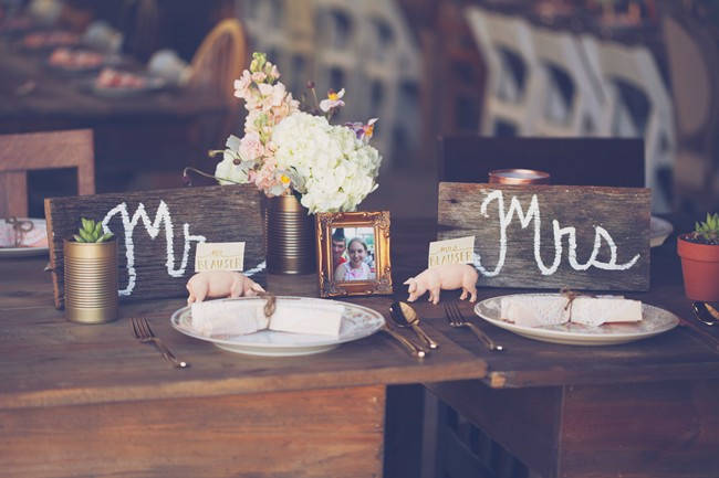 bride and groom place setting with wood MR and MRS signs, and pig figurine namecard holders