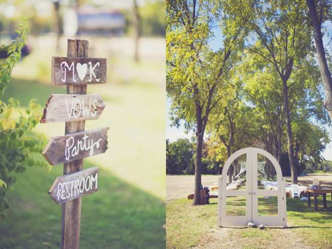 ceremony entrance of white wooden doors and wooden direction signs