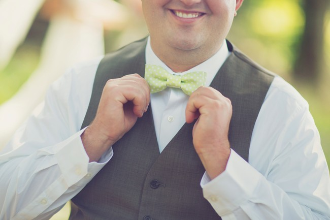 groom with a green bow tie