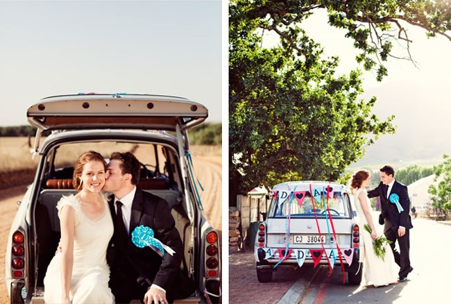 """Bride and groom leaving wedding in a """"just married"""" car"""