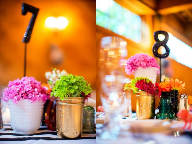 Black table numbers with bright flowers and gold mason jars