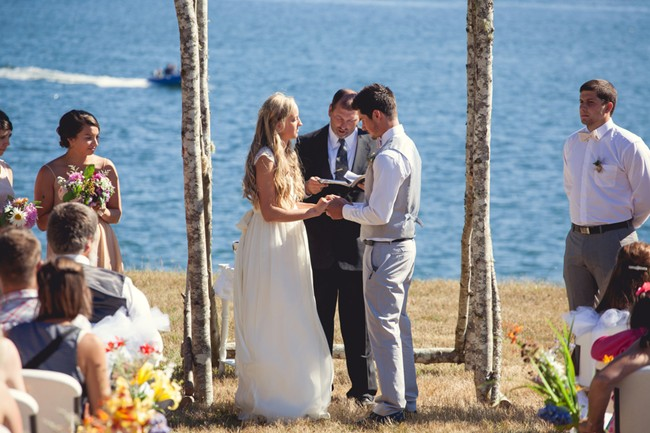 Bride and groom during wedding ceremony on orcas island  captured by aubrey joy photography
