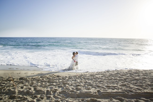 annivesary couple kiss in waves at Laguna beach