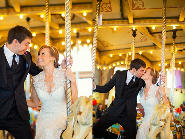 Bride and groom riding and kissing on a carousel