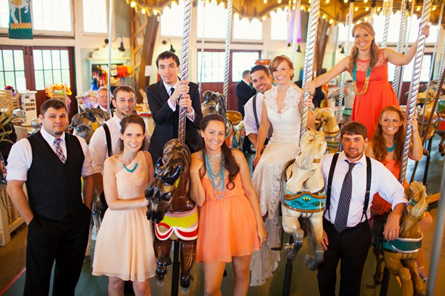 Bride and groom with bridal party on a carouesel
