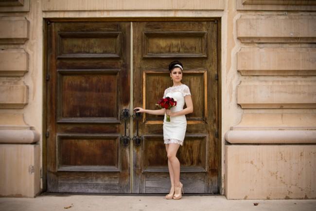 Bride wearing  Iselle Design Studio waiting at door  in Balboa Park