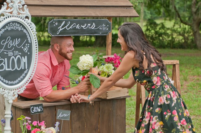 Engaged couple at flower stand